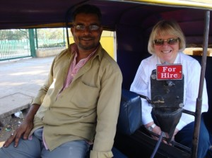 Annabel in auto rickshaw with driver (that's just the rickshaw that's for hire, not her!)...